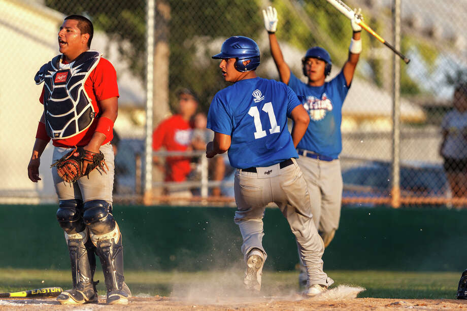 Brackenridge's Joseph Gonzalez (center) scores for the West all-stars as Jay's Jerry Montjano and East catcher Joseph Alcarez from Roosevelt look on during the Valley-Hi Optimist all-star game at Tejeda Sports Complex on May 29, 2012.  The West team won the game 16-2. Photo: MARVIN PFEIFFER, Marvin Pfeiffer/ Mpfeiffer@express-news.net / Express-News 2012