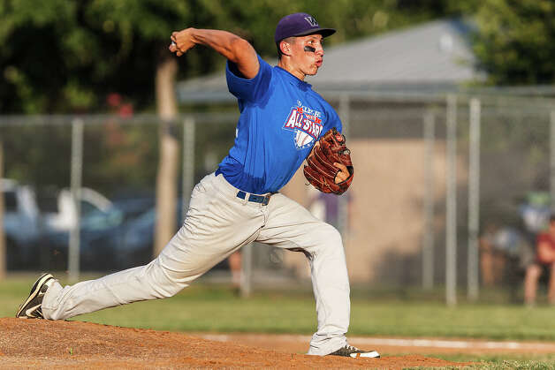 Warren's Robert Zamora throws to the plate for the West all-stars during the Valley-Hi Optimist all-star game at Tejeda Sports Complex on May 29, 2012. The West team won the game 16-2. Photo: MARVIN PFEIFFER, Marvin Pfeiffer/ Mpfeiffer@express-news.net / Express-News 2012