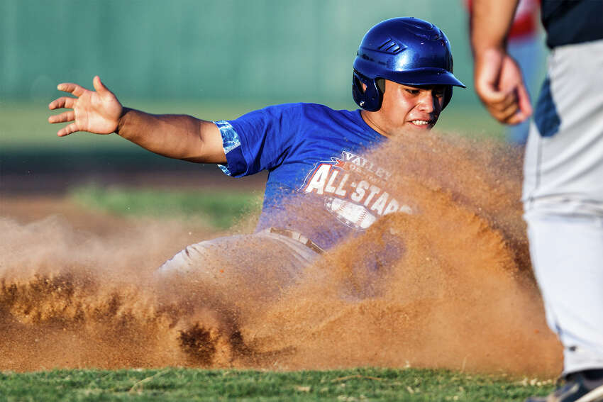 South San's Justin Flores, playing for the West all-stars, slides safely into third base during the Valley-Hi Optimist All-Star game at Tejeda Sports Complex on May 29, 2012.