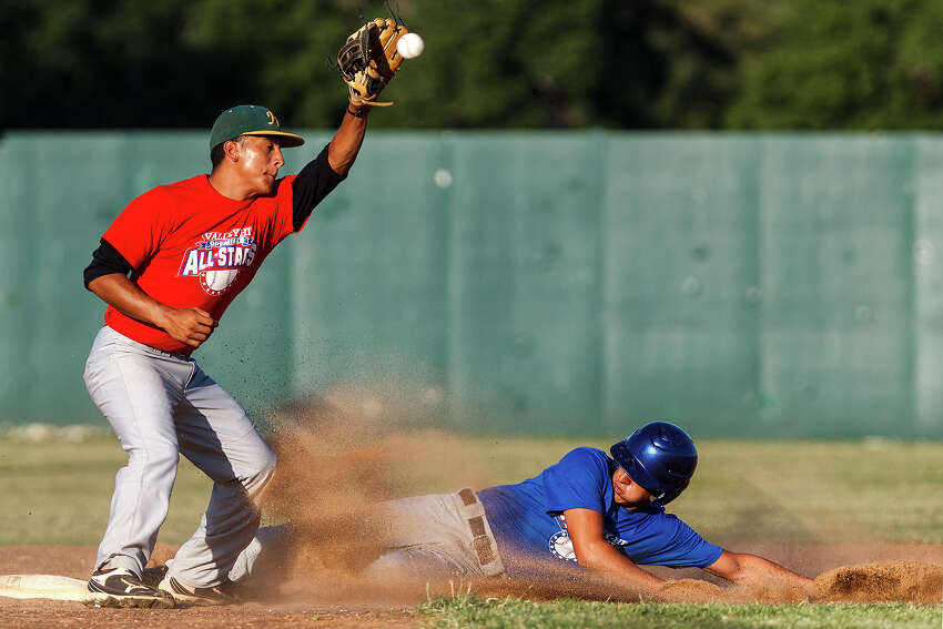 Marshall's Obed Rodriguez (right) beats the throw to Holmes' Kick Campos as he slides safely into second base during the Valley-Hi Optimist all-star game at Tejeda Sports Complex on May 29, 2012.