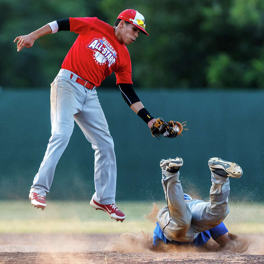 Brennan's James Alvarado (right), playing for the West all-stars, slides safely into second base as Lee's Isreal Martinez tries to apply the tag during the Valley-Hi Optimist all-star game at Tejeda Sports Complex on May 29, 2012.