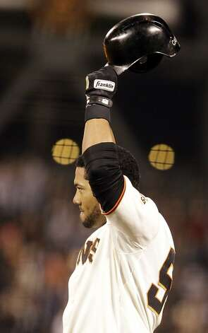 San Francisco Giants' Melky Cabrera waves his helmet to fans after hitting a single off Arizona Diamondbacks' Bryan Shaw in the eighth inning of a baseball game Tuesday, May 29, 2012, in San Francisco. Cabrera broke the Giants hit record for May with the hit, previously held by Willie Mays. (AP Photo/Ben Margot) Photo: Ben Margot, Associated Press