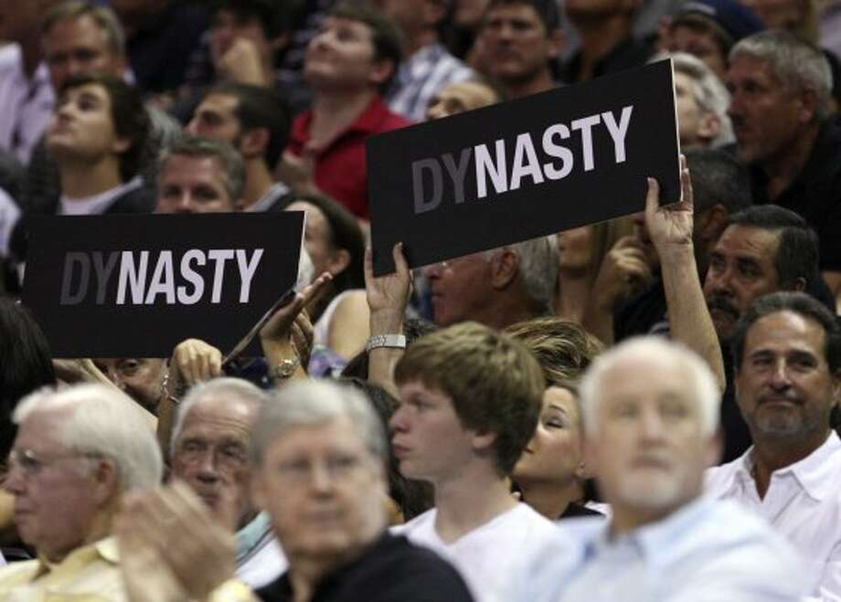 Fans hold up signs during the first half of game two of the NBA Western Conference Finals in San Antonio, Texas on Tuesday, May 29, 2012. (Edward A. Ornelas / San Antonio Express-News)