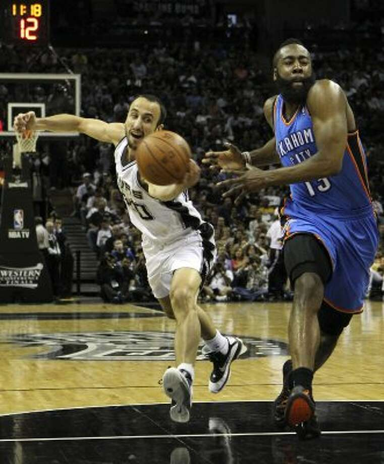 San Antonio Spurs' Manu Ginobili (20) swipes the ball away from Oklahoma City Thunder's James Harden (13) during the first half of game two of the NBA Western Conference Finals in San Antonio, Texas on Tuesday, May 29, 2012. Kin Man Hui/Express-News (Kin Man Hui / San Antonio Express-News)