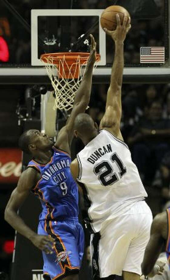San Antonio Spurs' Tim Duncan (21) dunks against Oklahoma City Thunder's Serge Ibaka (9) during the first half of game two of the NBA Western Conference Finals in San Antonio, Texas on Tuesday, May 29, 2012. Kin Man Hui/Express-News (Kin Man Hui / San Antonio Express-News)