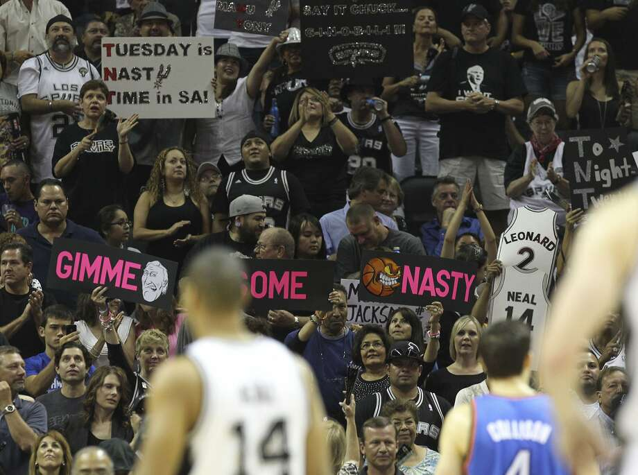 Fans hold up signs during the first half of game two of the NBA Western Conference Finals in San Antonio, Texas on Tuesday, May 29, 2012. Kin Man Hui/Express-News (Kin Man Hui / San Antonio Express-News)