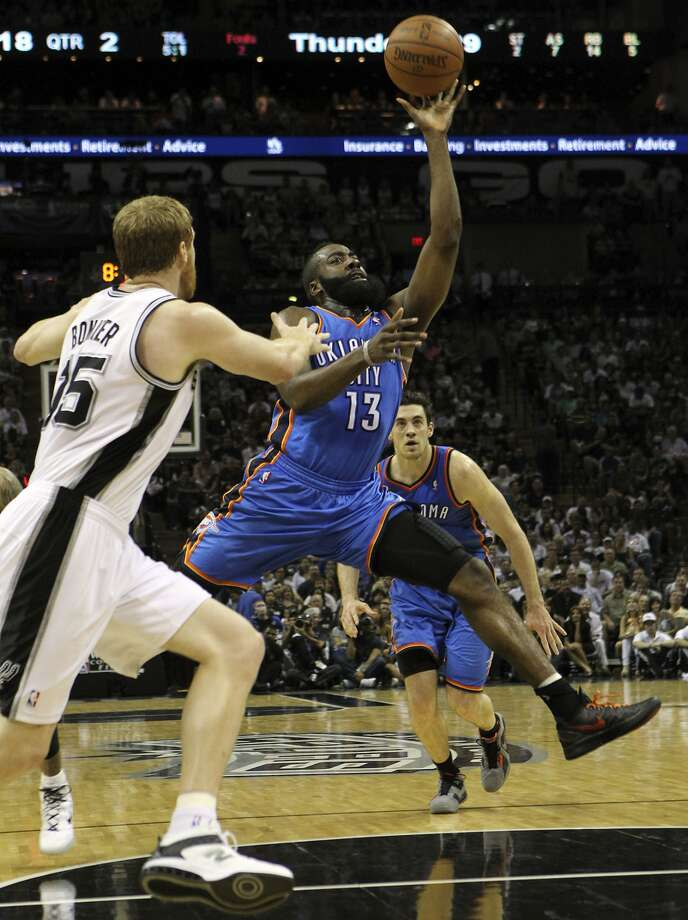 Oklahoma City Thunder's James Harden (13) drives against San Antonio Spurs' Matt Bonner (15) during the first half of game two of the NBA Western Conference Finals in San Antonio, Texas on Tuesday, May 29, 2012. Kin Man Hui/Express-News (Kin Man Hui / San Antonio Express-News)