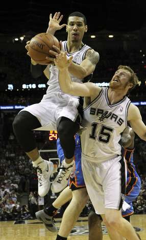 San Antonio Spurs' Danny Green (4) grabs a rebound near San Antonio Spurs' Matt Bonner (15) during the first half of game two of the NBA Western Conference Finals in San Antonio, Texas on Tuesday, May 29, 2012. Kin Man Hui/Express-News (Kin Man Hui / San Antonio Express-News)