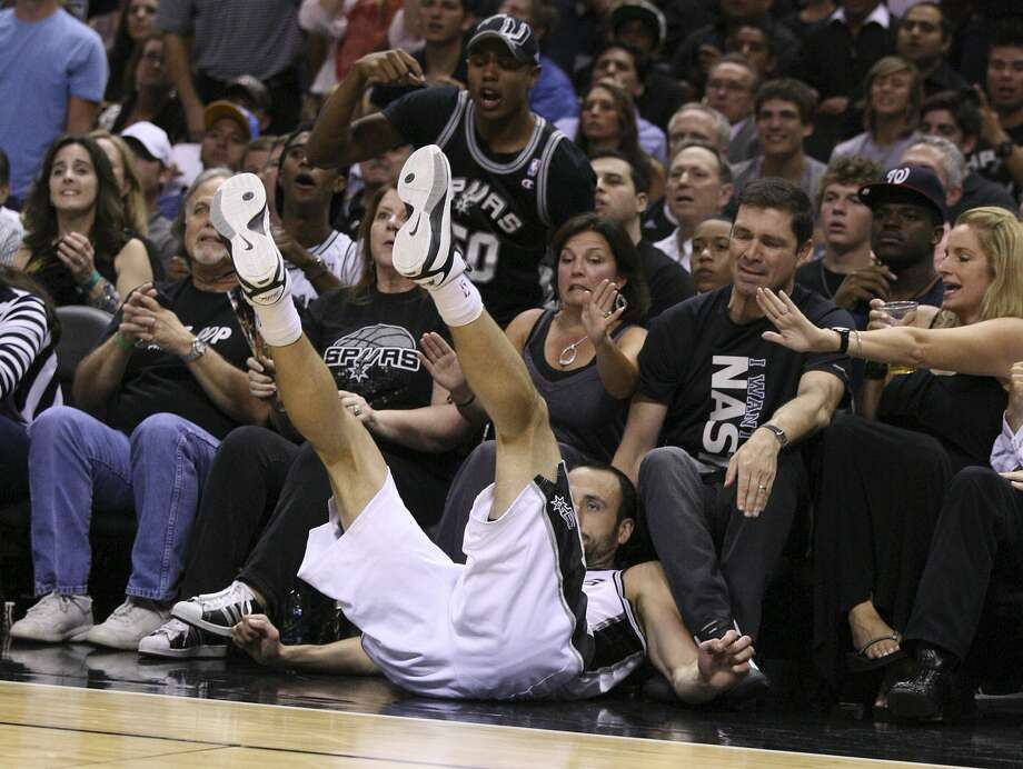 San Antonio Spurs' Manu Ginobili (20) falls out of bounds after the play during the first half of game two of the NBA Western Conference Finals in San Antonio, Texas on Tuesday, May 29, 2012.  Edward A. Ornelas/Express-News (Edward A. Ornelas / San Antonio Express-News)