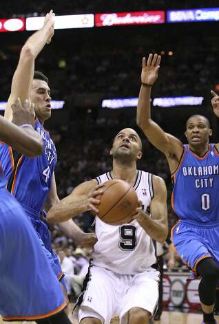 San Antonio Spurs' Tony Parker (9) shoots against Oklahoma City Thunder's Nick Collison (4) and Oklahoma City Thunder's Russell Westbrook (0) during the first half of game two of the NBA Western Conference Finals in San Antonio, Texas on Tuesday, May 29, 2012.  Edward A. Ornelas/Express-News (Edward A. Ornelas / San Antonio Express-News)