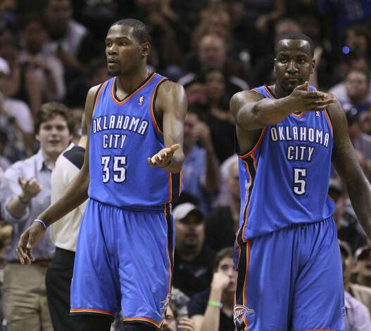 Oklahoma City Thunder's Kevin Durant (35) and Oklahoma City Thunder's Kendrick Perkins (5) gesture for possession of the ball during the first half of game two of the NBA Western Conference Finals in San Antonio, Texas on Tuesday, May 29, 2012.  Edward A. Ornelas/Express-News (Edward A. Ornelas / San Antonio Express-News)