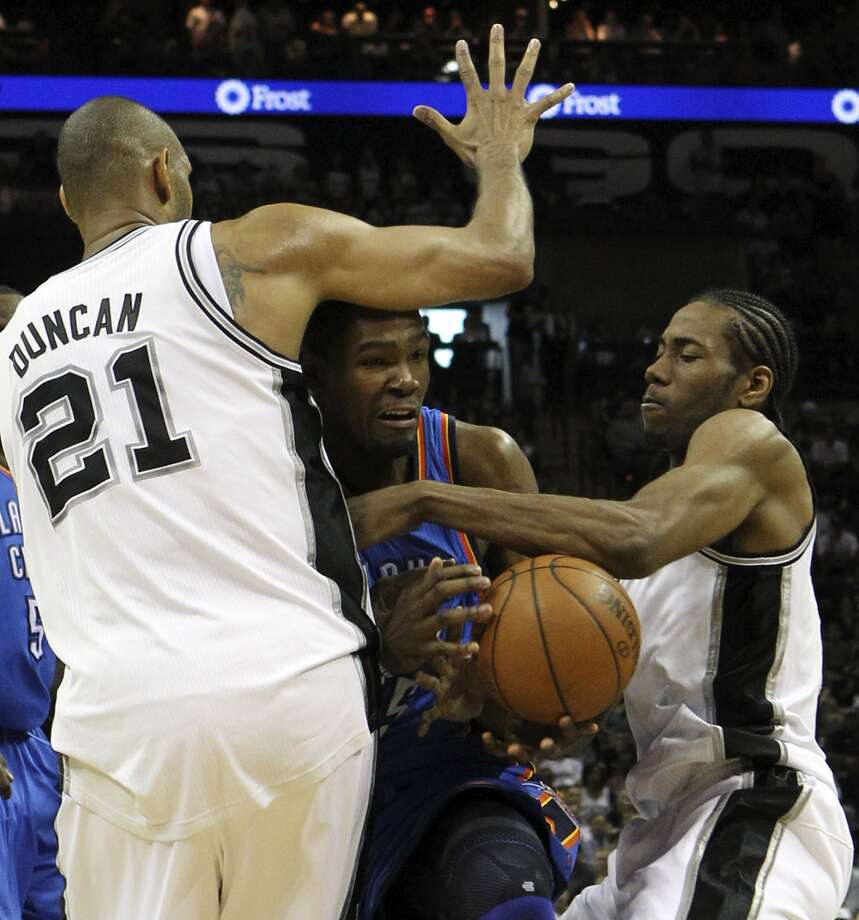Oklahoma City Thunder's Kevin Durant (35) is trapped between San Antonio Spurs' Tim Duncan (21) and San Antonio Spurs' Kawhi Leonard (2) during the first half of game two of the NBA Western Conference Finals in San Antonio, Texas on Tuesday, May 29, 2012. Kin Man Hui/Express-News (Kin Man Hui / San Antonio Express-News)