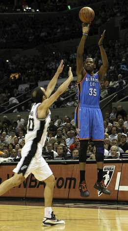 Oklahoma City Thunder's Kevin Durant (35) shoots over San Antonio Spurs' Manu Ginobili (20) during the first half of game two of the NBA Western Conference Finals in San Antonio, Texas on Tuesday, May 29, 2012. Kin Man Hui/Express-News (Kin Man Hui / San Antonio Express-News)