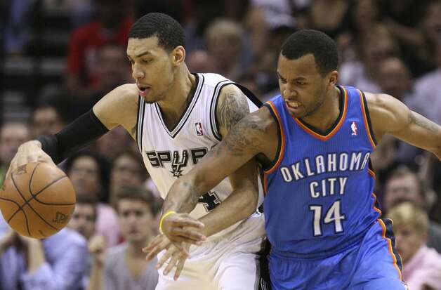 San Antonio Spurs' Danny Green (4) maintains control of the ball against Oklahoma City Thunder's Daequan Cook (14) during the first half of game two of the NBA Western Conference Finals in San Antonio, Texas on Tuesday, May 29, 2012.  Edward A. Ornelas/Express-News (Edward A. Ornelas / San Antonio Express-News)