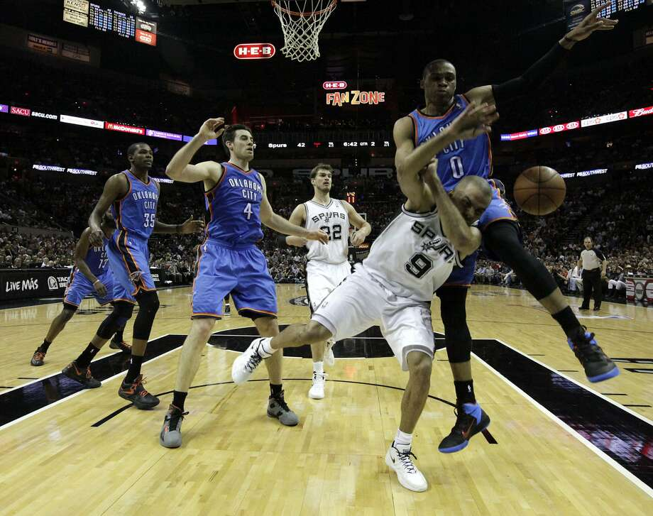 San Antonio Spurs' Tony Parker (9) is fouled by Oklahoma City Thunder's Russell Westbrook (0) during the first half of game two of the NBA Western Conference Finals in San Antonio, Texas on Tuesday, May 29, 2012. Kin Man Hui/Express-News (Kin Man Hui / San Antonio Express-News)