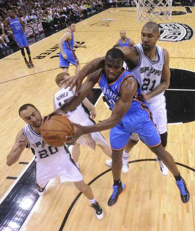 Oklahoma City Thunder's Serge Ibaka (9) is pressured by San Antonio Spurs' Manu Ginobili (20) and San Antonio Spurs' Tim Duncan (21) during the first half of game two of the NBA Western Conference Finals in San Antonio, Texas on Tuesday, May 29, 2012.  Edward A. Ornelas/Express-News (Edward A. Ornelas / San Antonio Express-News)