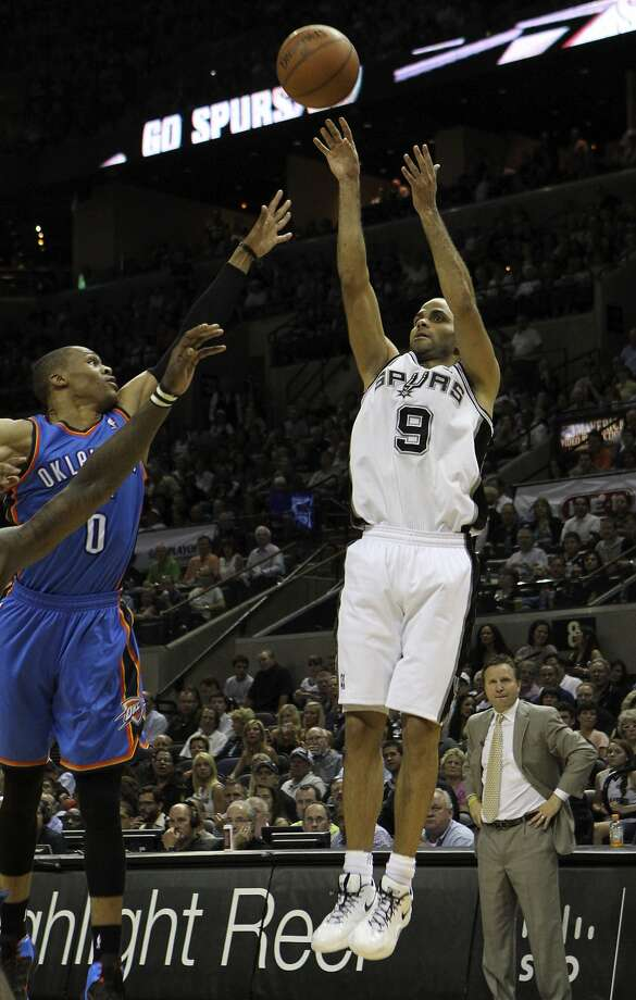 San Antonio Spurs' Tony Parker (9) shoots over Oklahoma City Thunder's Russell Westbrook (0) during the second half of game two of the NBA Western Conference Finals in San Antonio, Texas on Tuesday, May 29, 2012. Kin Man Hui/Express-News (Kin Man Hui / San Antonio Express-News)
