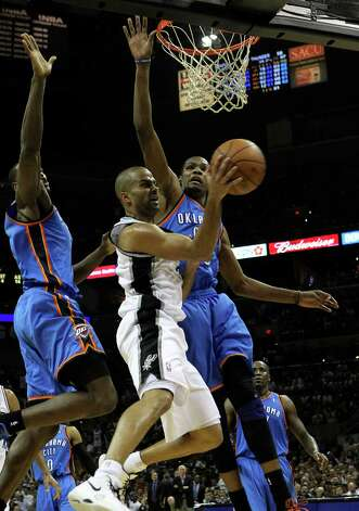 San Antonio Spurs' Tony Parker (9) passes around Oklahoma City Thunder's Kevin Durant (35) during the second half of game two of the NBA Western Conference Finals in San Antonio, Texas on Tuesday, May 29, 2012. Kin Man Hui/Express-News Photo: Kin Man Hui, San Antonio Express-News / © 2012 San Antonio Express-News
