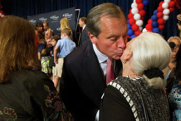 U.S. Senate candidate David Dewhurst kisses a supporter after addressing a primary watch party at the Intercontinental Hotel on Tuesday, May 29, 2012, in Houston. Photo: Smiley N. Pool, Houston Chronicle / © 2012  Houston Chronicle