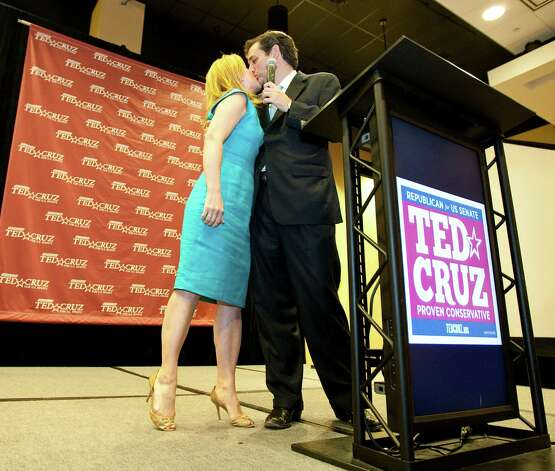 Ted Cruz, Republican candidate for U.S. Senator, gets a kiss from his wife Heidi Cruz as he acknowledges her during his speech at his primary election watch party, Tuesday, May 29, 2012, in the JW Marriott Houston in Houston. Cruz will run against Texas Lt. Governor David Dewhurst , who he challenged to five debates. Photo: Nick De La Torre, Houston Chronicle / © 2012  Houston Chronicle