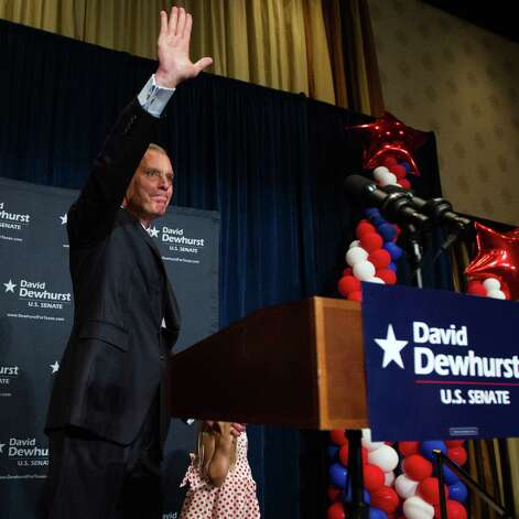 U.S. Senate candidate David Dewhurst waves to a crowd of supporters at the Intercontinental Hotel during a primary watch party on Tuesday, May 29, 2012, in Houston. Photo: Smiley N. Pool, Houston Chronicle / © 2012  Houston Chronicle