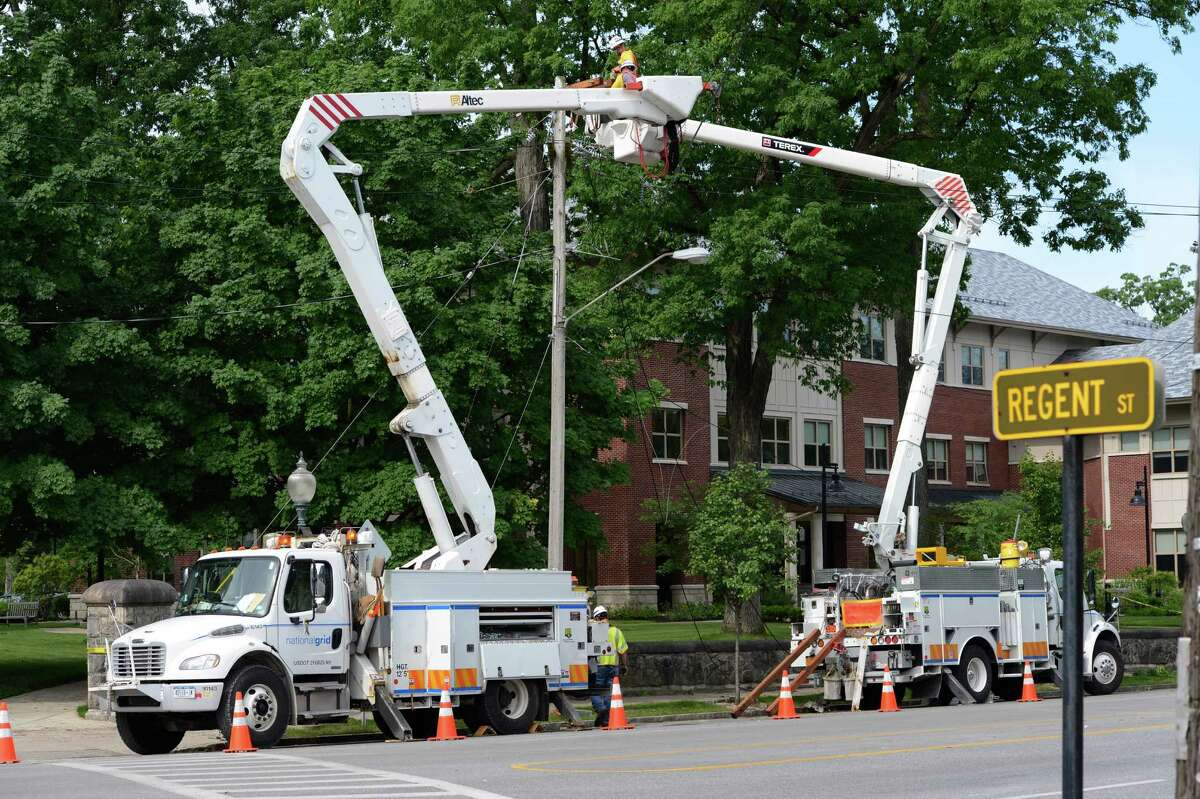 National Grid workers repair damage May 30, 2012, caused by a severe storm yesterday afternoon in front of Empire State College on Union Avenue between Regent Street and Circular Avenue in Saratoga Springs, N.Y. (Skip Dickstein / Times Union)