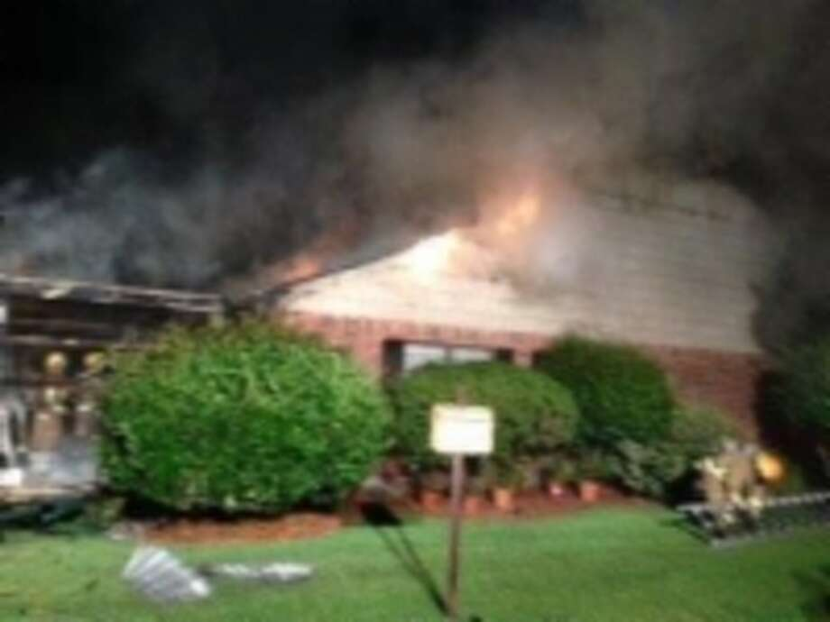 Beaumont Fire Rescue units arrived at the town homes in the 5700 block of Meadow Way at around 9:30 p.m. Tuesday. When they arrived, the garage and the end unit of a five-unit town home structure was on fire. Photo: Beaumont Fire Department