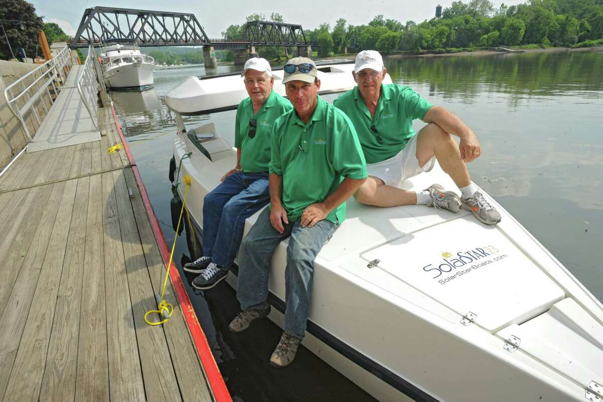 A SolarSTAR23 boat is docked at the Waterford Visitor Center May 29, 2012 in Wateford, N.Y. The solar powered boat was crewed by three men from Arizona on a 363-mile trip on the Erie Canal from Buffalo to Waterford. The crew from left is Jack Caple, Bruce Walton and Robert Meacham. (Lori Van Buren / Times Union)