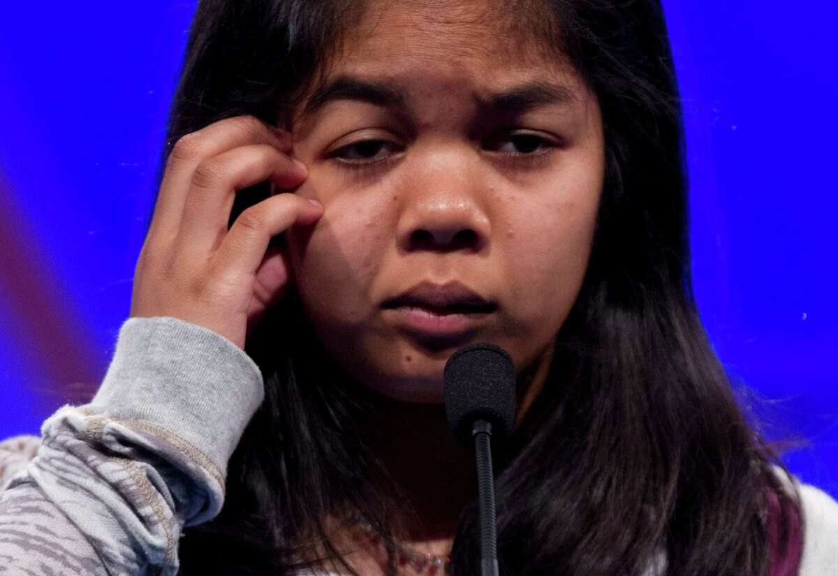 Amber Born, of Marblehead, Mass., pauses during the second round of National Spelling Bee, Wednesday, May 30, 2012, in Oxon Hill, Md.
