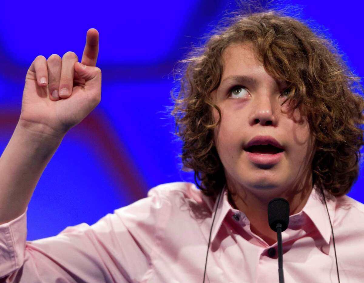 Sam Lowery, of Charlestown, Mass., spells his word in the air during round two of the National Spelling Bee, Wednesday, May 30, 2012, in Oxon Hill, Md.