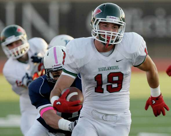 Wide receiver Jayme Taylor #19 of The Woodlands Highlanders runs after the catch against the Kingwood Mustangs in a high school football game at Turner Stadium in Humble, Texas. Photo: Thomas B. Shea / Freelance