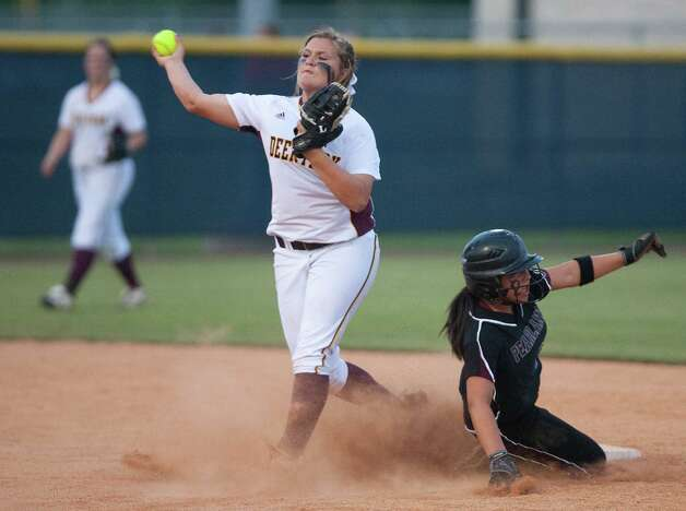 Deer Park's Lexi Fryar, left, makes a throw to first in an attempt of a double play in a recent playoff game. Photo: Cody Duty / © 2011 Houston Chronicle