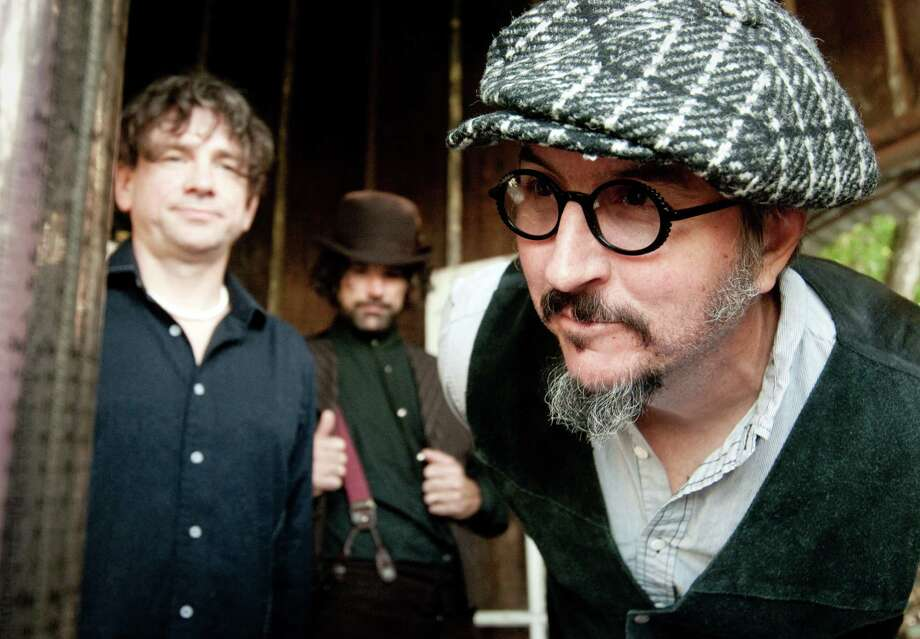 "Primus' bassist/singer Les Claypool, right, says the band's latest album, ""Green Naugahyde,"" mixes the band's trademark humor with some dark themes. Photo: Tod Brilliant"