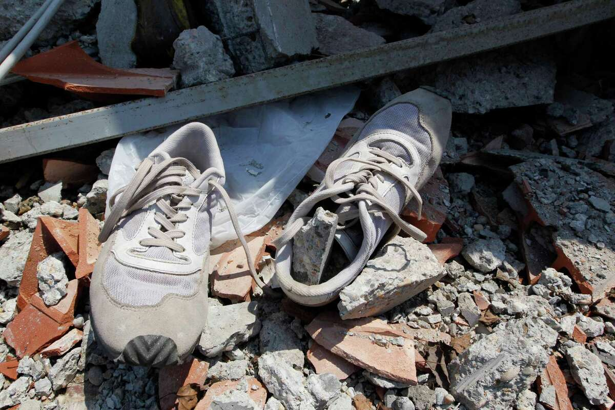 A pair of shoes is seen amid debris of the collapsed BBG industrial moldings building in Mirandola, northern Italy, Wednesday. A magnitude 5.8 earthquake struck the same area of northern Italy stricken by another fatal tremor on May 20.