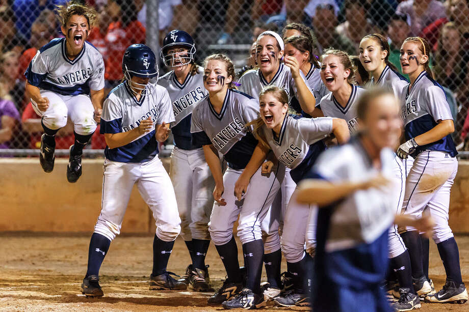 The Smithson Valley Lady Rangers celebrate at home plate as they wait for Celena Massey to come in after Massey's ninth-inning, two-run home run that proved to be the difference in their Region IV-4A final game with New Braunfels Canyon at NEISD Softball Complex on May 24, 2012.  Smithson Valley advanced to the state tournament with a 7-5 victory in nine innings over the Lady Cougars.  Photo by Marvin Pfeiffer / Prime Time Newspapers Photo: MARVIN PFEIFFER, Marvin Pfeiffer / Prime Time Newspapers / Prime Time Newspapers 2012