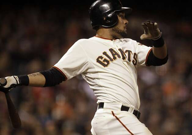 San Francisco Giants' Melky Cabrera swings for a single off Arizona Diamondbacks' Bryan Shaw in the eighth inning of a baseball game Tuesday, May 29, 2012, in San Francisco. Cabrera broke the Giants hit record for May with the hit, previously held by Willie Mays. Photo: Ben Margot, Associated Press