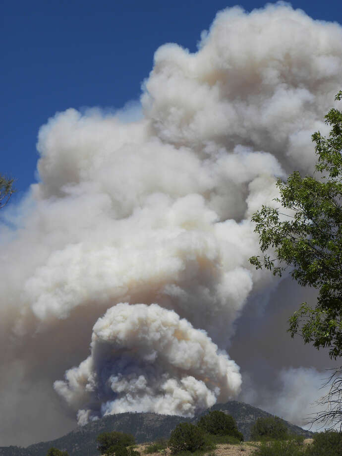 This May 29, 2012 photo provided by the US Forest Service Gila National Forest shows the massive blaze in the Gila National Forest, seen from�Neighbors Mountain directly east of Glenwood, N.M.�Fire officials said Wednesday May 30, 2012 the�wildfire has burned more than 265 square miles has become the largest fire in New Mexico history.� Photo: Ap