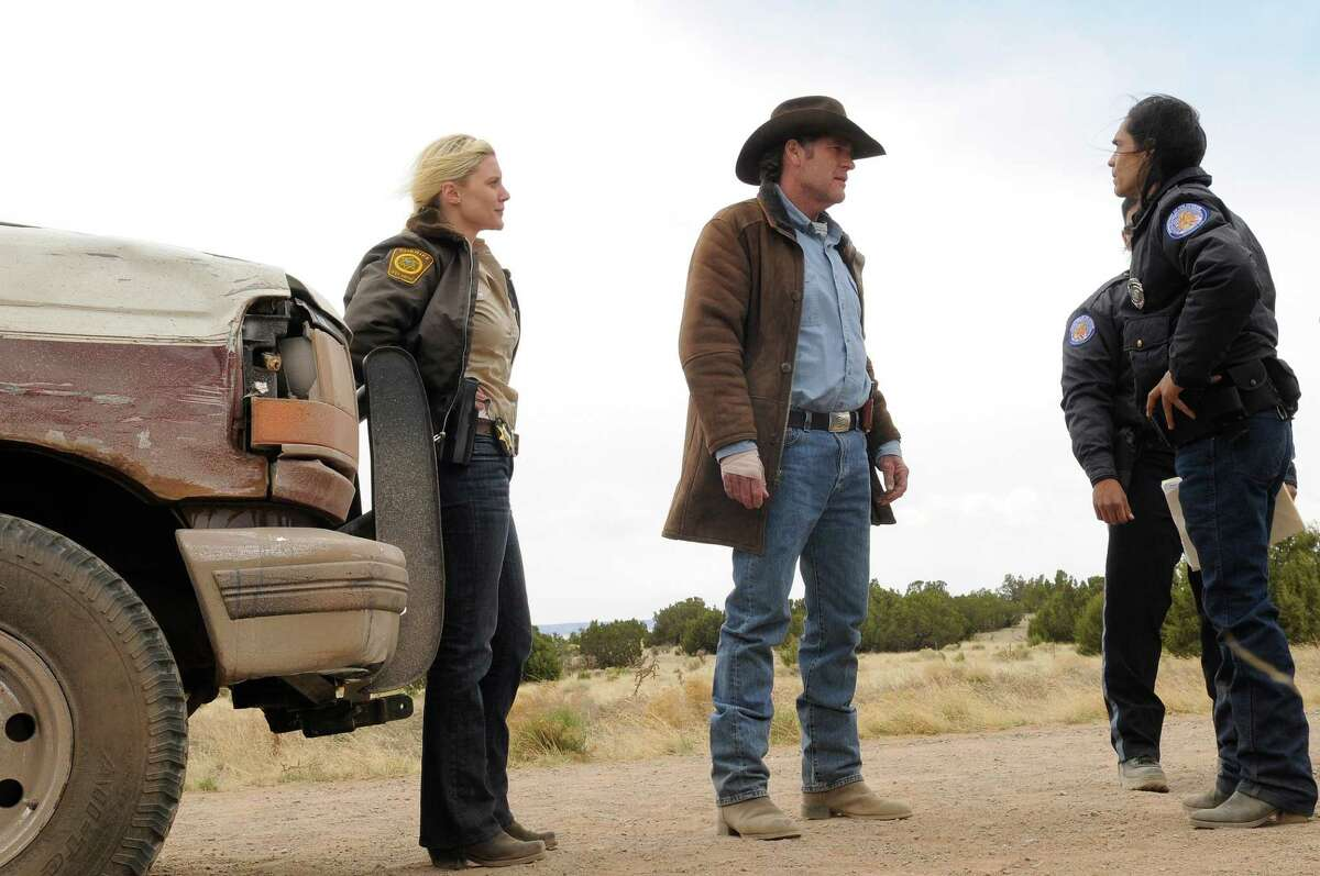 """Sheriff Longmire (center), played by Robert Taylor, and his deputy (Katee Sackhoff, far left) take up a criminal matter with the tribal police in the Wyoming set contemporary Western, """"Longmire."""""""