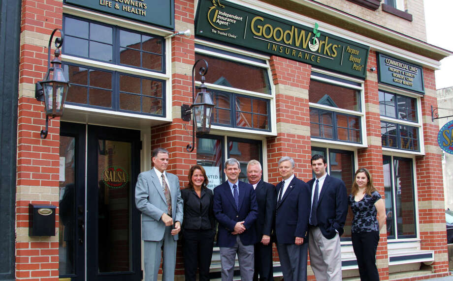 GoodWorks Insurance, which operates under a business model that calls for donating 50 percent of profits to local charities, has opened in New Milford. From left to right are staff members Peter Gay, Kelly Zecchin, Paul Brian, Bob Johnson, Neil Scranton, Bryce Finnan, and Kristin Hopkins. Photo: Contributed Photo