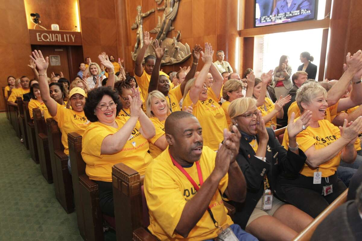 Employees of Southwest Airlines applaud Wednesday after Houston City Council voted to approve a Hobby Airport expansion that involves the creation of an international terminal.