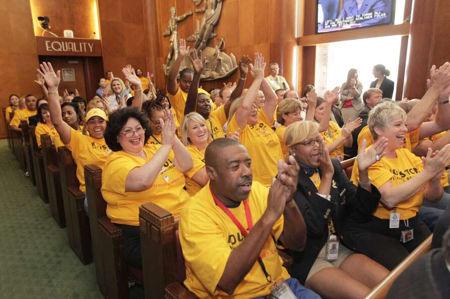 Employees of Southwest Airlines applaud Wednesday after Houston City Council voted to approve a H