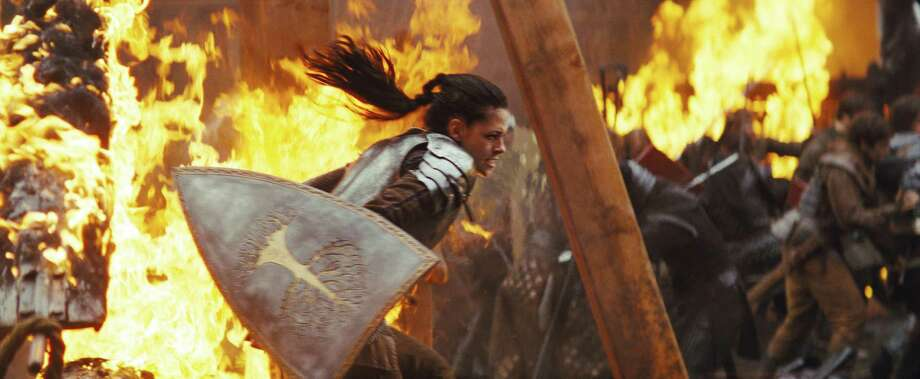 """This film image released by Universal Pictures shows actress Kristen Stewart in a scene from """"Snow White and the Huntsman."""" (AP Photo/Universal Pictures) Photo: Universal Pictures / Copyright: © 2012 Universal Studios. ALL RIGHTS RESERVED."""