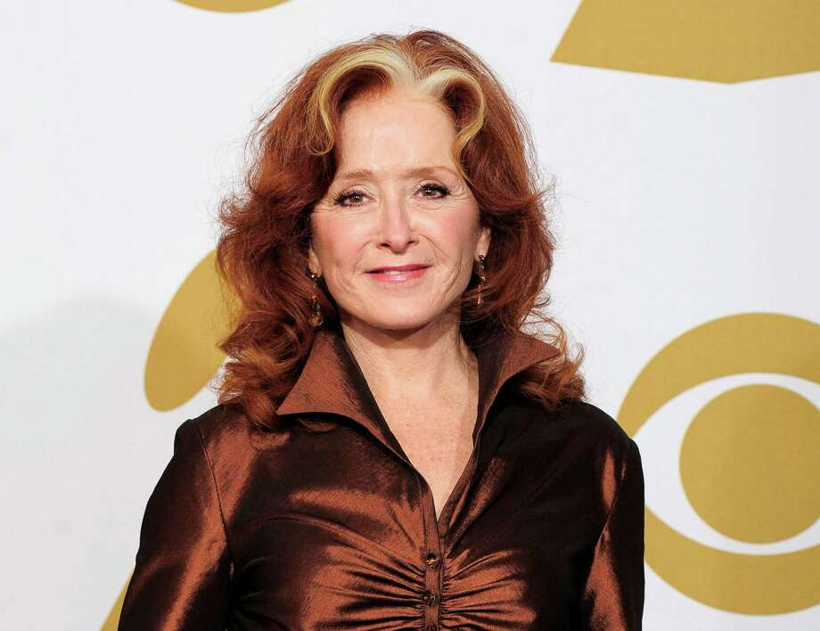 FILE - In this Feb. 12, 2012 file photo, singer Bonnie Raitt poses backstage at the 54th annual Grammy Awards in Los Angeles. (AP Photo/Mark J. Terrill, File) Photo: Mark J. Terrill
