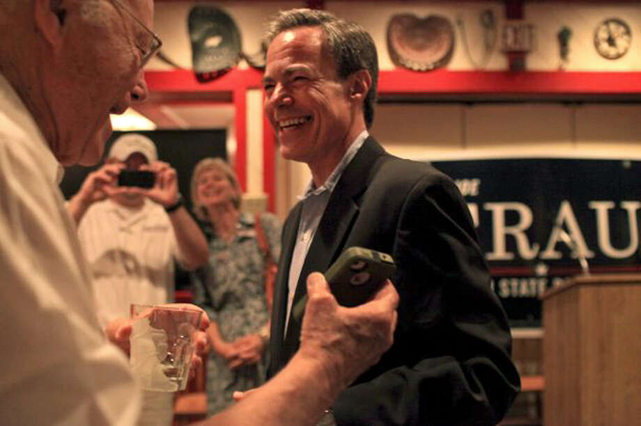 Texas House Speaker Joe Straus laughs with his father, Joe Straus Jr. (left) during the watch party for Straus supporters at the Barn Door restaurant. Straus defeated Matt Beebe in the GOP primary. (Lisa Krantz / San Antonio Express-News)