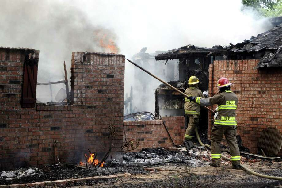 A home on John Hare Road in Silsbee was completely destroyed by fire Wednesday, May 30. Firefighters from Silsbee Volunteer Fire Department arrived at the home shortly after 11:30 a.m. to discover it engulfed in flames. Photo: David Lisenby, HCN_May 30 Fire