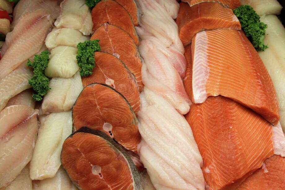 Supermarket fish case Photo: Rick Bowmer / AP