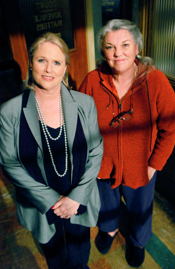 "** ADVANCE FOR WEEKEND EDITIONS, FEB. 7-9 ** Actors Sharon Gless, left, and Tyne Daly, stars of the 1980s cop series ""Cagney & Lacey,"" pose on the set of ""Judging Amy"" at the Fox Studios in Los Angeles, Jan. 10, 2003. In the CBS series, Daly portrays social worker Maxine Gray, mother to title character Judge Amy Gray. Gless guest-stars as a social services official investigating complaints against Maxine, her one-time college roommate.  (AP Photo/Ann Johansson) Photo: ANN JOHANSSON"