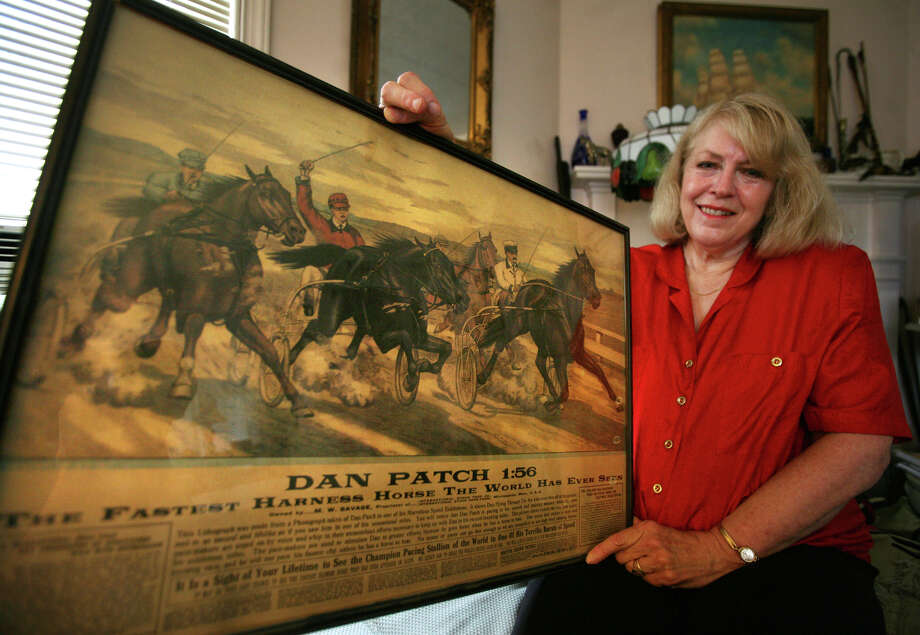 Author Sharon B. Smith of Milford holds a poster of the harness horse Dan Patch, a racing a marketing phenomenon from the first decade of the twentieth century. Smith's new book, The Best There Ever Was: Dan Patch and the Dawn of the American Century, is being released on July 1. Photo: Brian A. Pounds / Connecticut Post