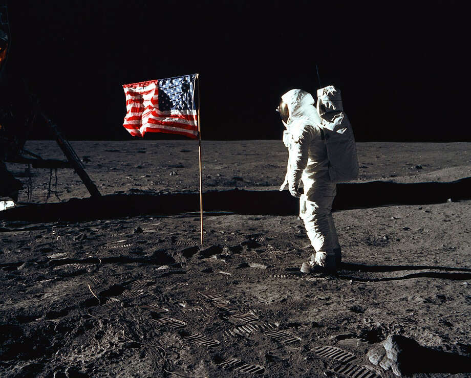 Astronaut Buzz Aldrin poses for a photograph beside the American flag on the Moon on July 20, 1969, during the Apollo 11 mission. Photo: Neil Armstrong/NASA