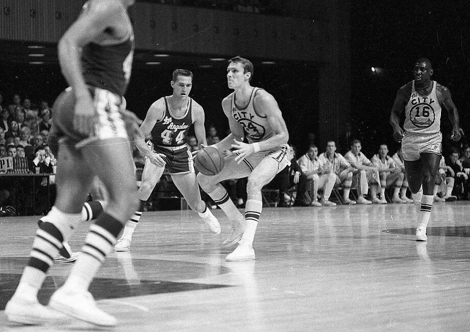 San Francisco Warriors guard Rick Barry is guarded by Jerry West during a game against the Lakers at the Civic Auditorium on Nov. 11, 1966. Photo: Art Frisch, The Chronicle